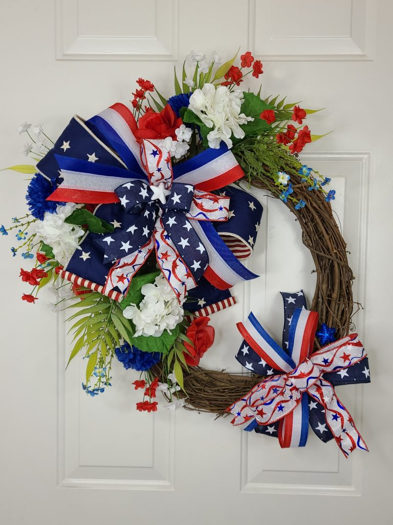Patriotic/4th of July Wreath with double bows on a grapevine. Red, White & Blue